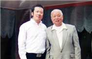 Karl with Chen Liang (Conductor)